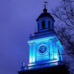 Gilman Hall on the Homewood Campus is lit blue for the start of World Autism Month.