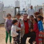 Bakdash, the MEHP candidate, surrounded by Syrian refugee children.
