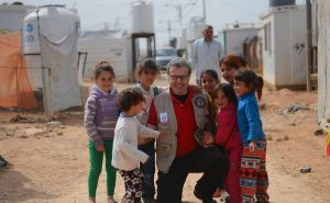 Bakdash, an MEHP candidate, surrounded by Syrian refugee children