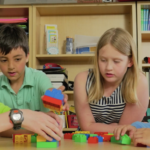 Kids building with blocks. Block building is common, accessible, and fun.