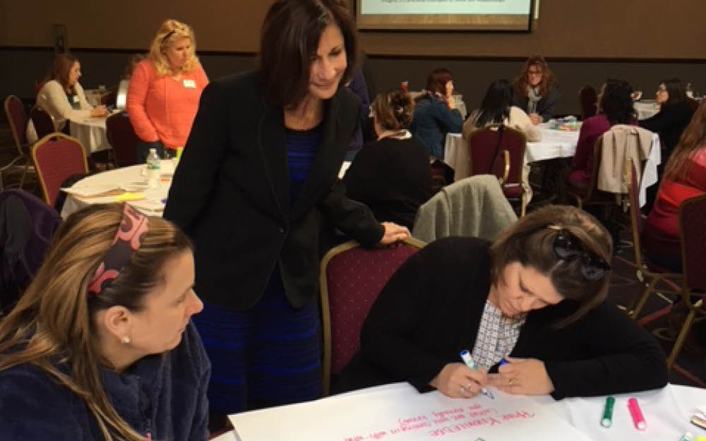 Mariale Hardiman, standing, convened with educators at a recent Brain-Targeted Teaching workshop Image
