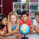 Children around a globe