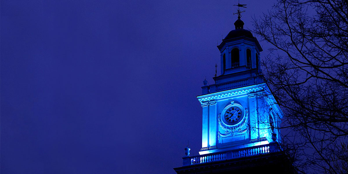Gilman Hall lit up blue for Autism Awareness Month