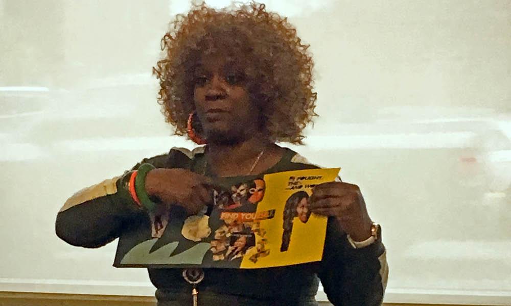 Henderson-Hopkins teacher explaining collage