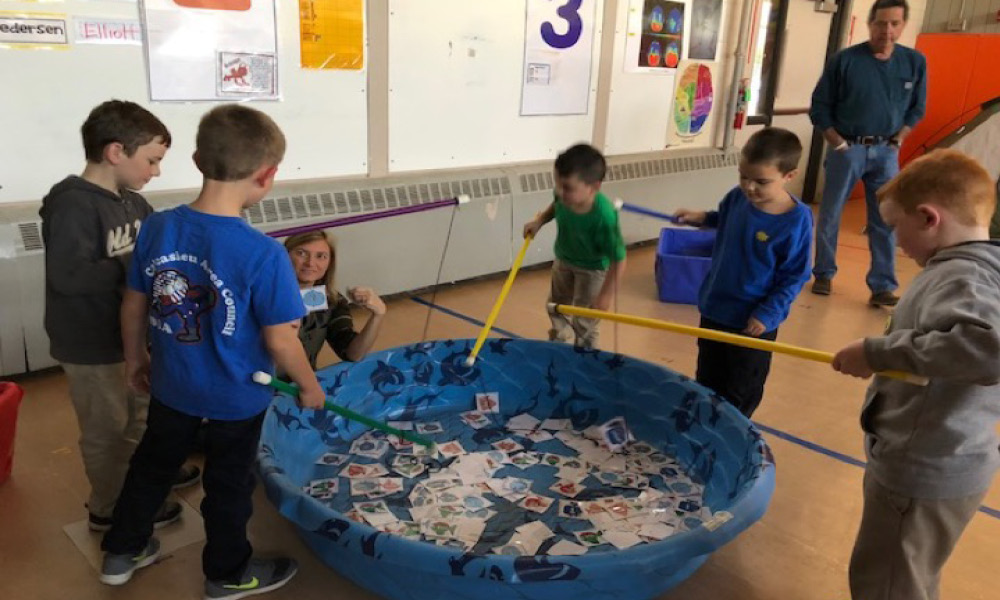 Children playing for paper fish