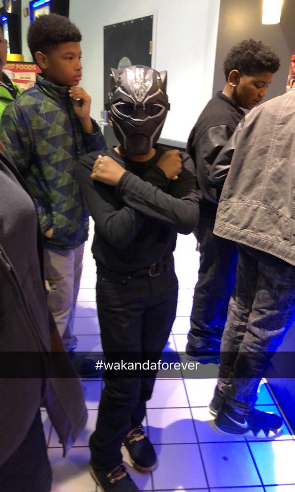 Student wearing black panther mask