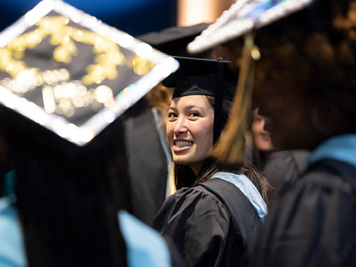 Woman smiling at commencement ceremony