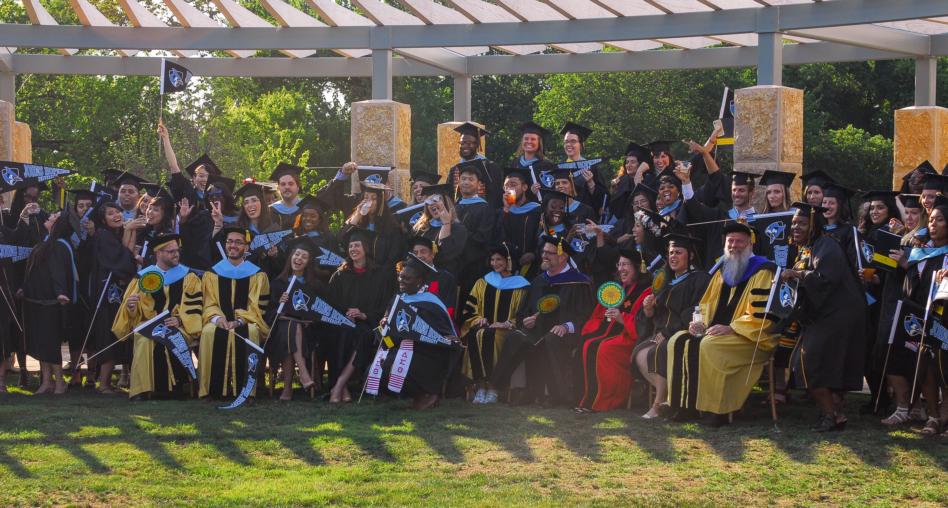 Graduates and faculty at the reception