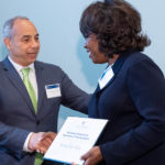 Dean Morphew shaking hand of a Society of Excellence Award recipient
