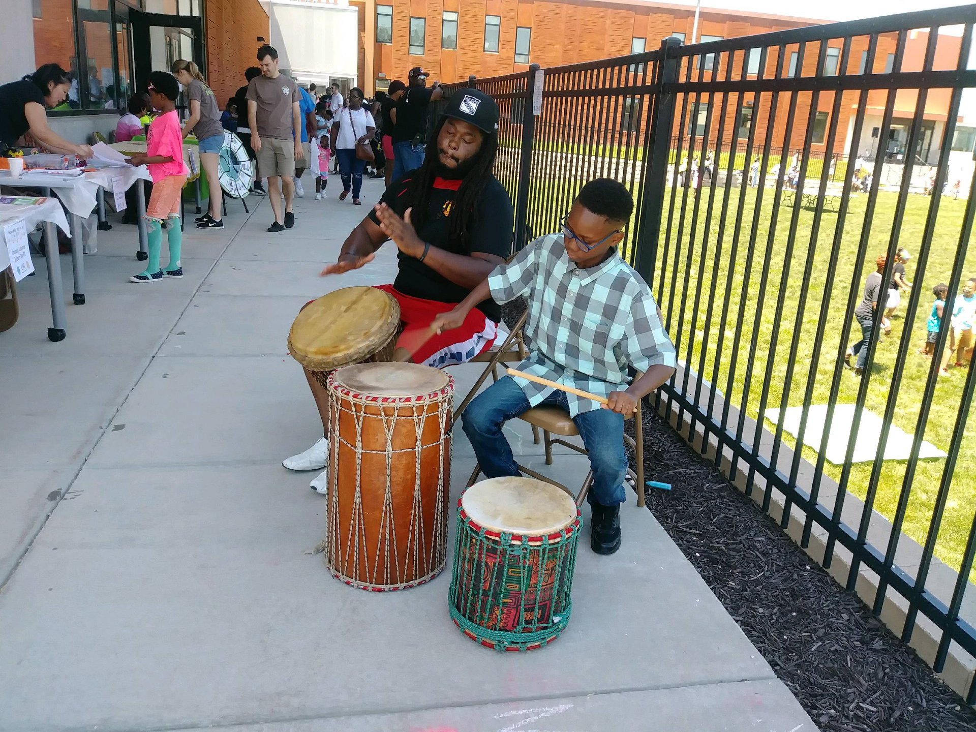 Two people playing drums