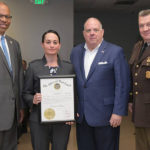 Left to right: Lt. Gov. Boyd Rutherford, Melissa Hyatt, Gov. Larry Hogan, Col. William M. Pallozzi