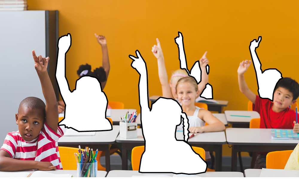 Students raising their hands to answer a question in the Classroom
