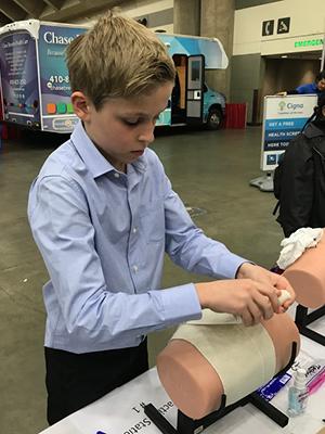 Boy applies Bandage