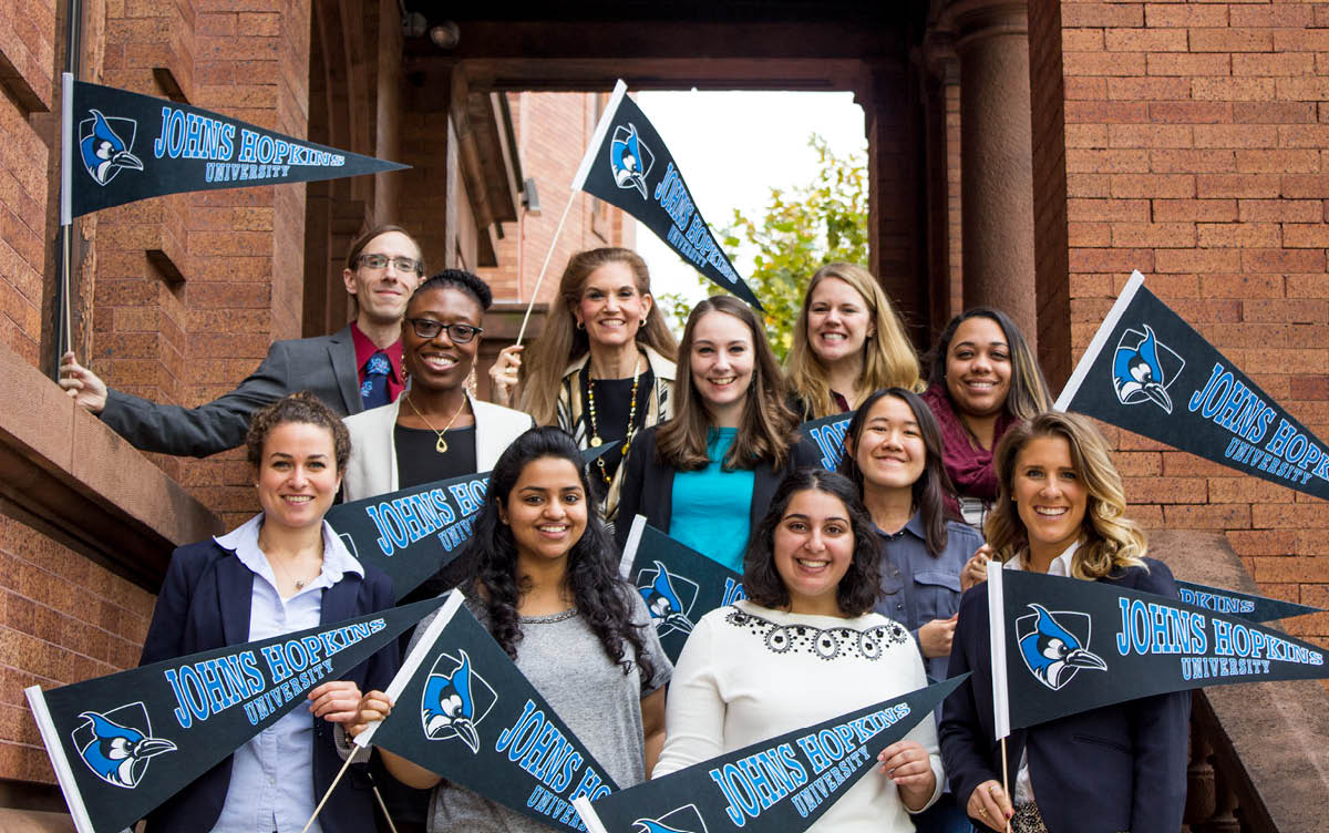 Representatives wave JHU flag before Spring 2019 Open House