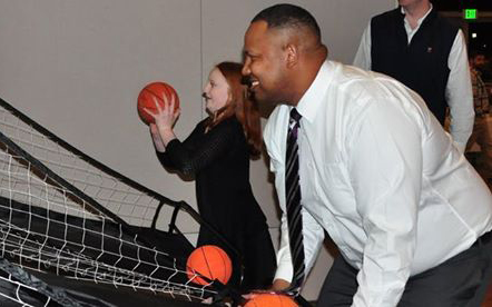 Event attendees playing casual basketball/Wall Street mash-up