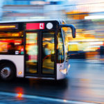 motion blur picture of a driving bus in the city at night