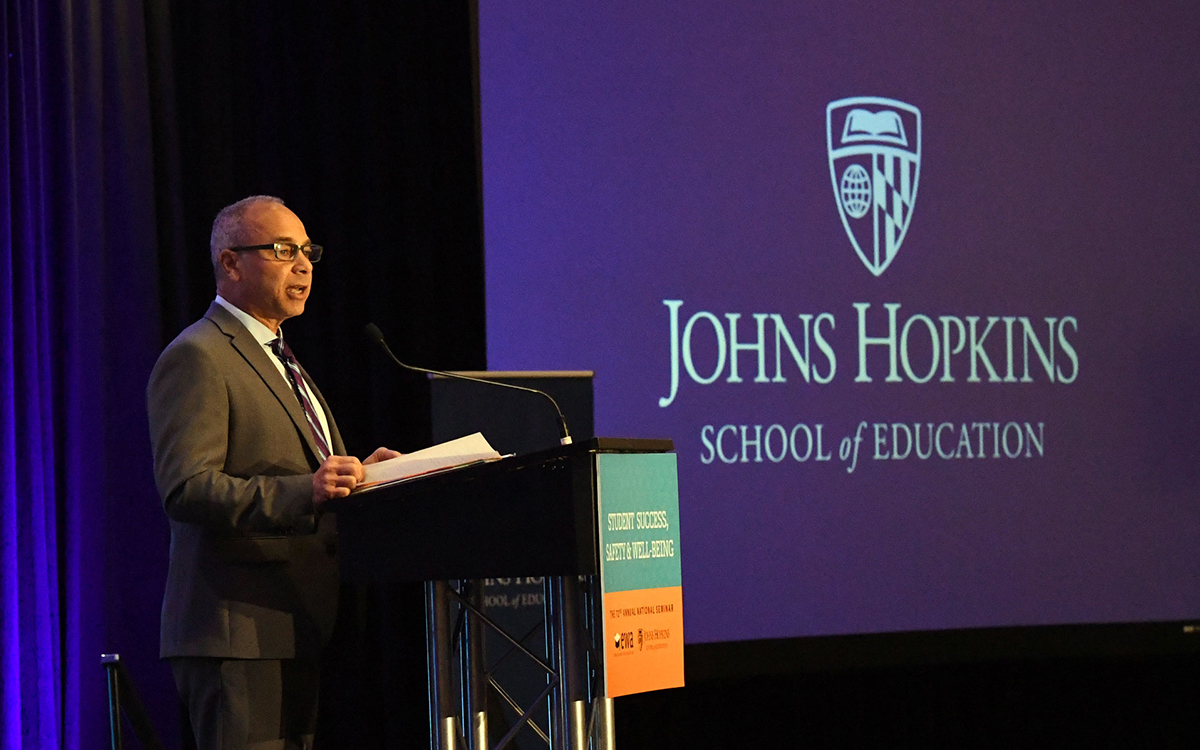Dean Morphew speaking at a podium announcing the Johns Hopkins Center for Safe and Healthy Schools