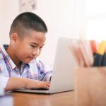 Boy using his laptop