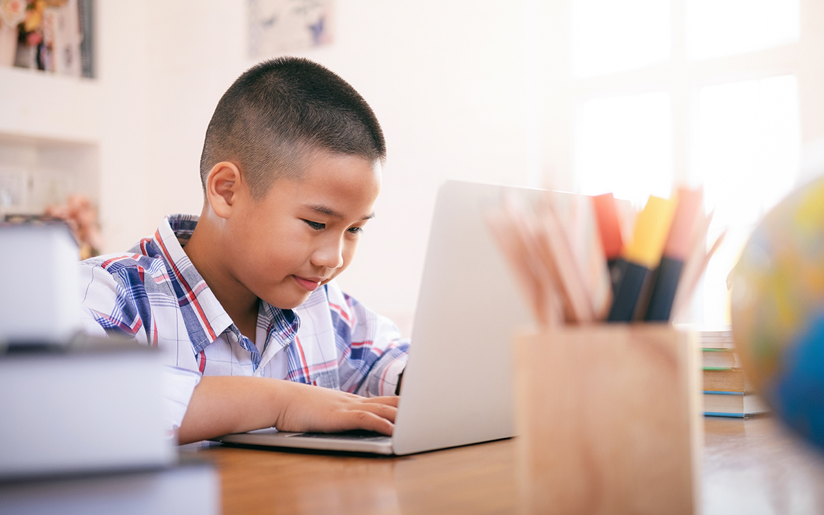 Boy using his laptop