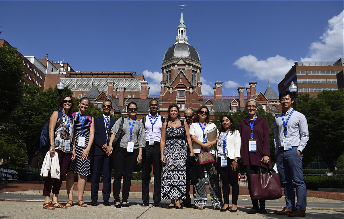 MEHP students posing in front of Johns Hopkins Hospital