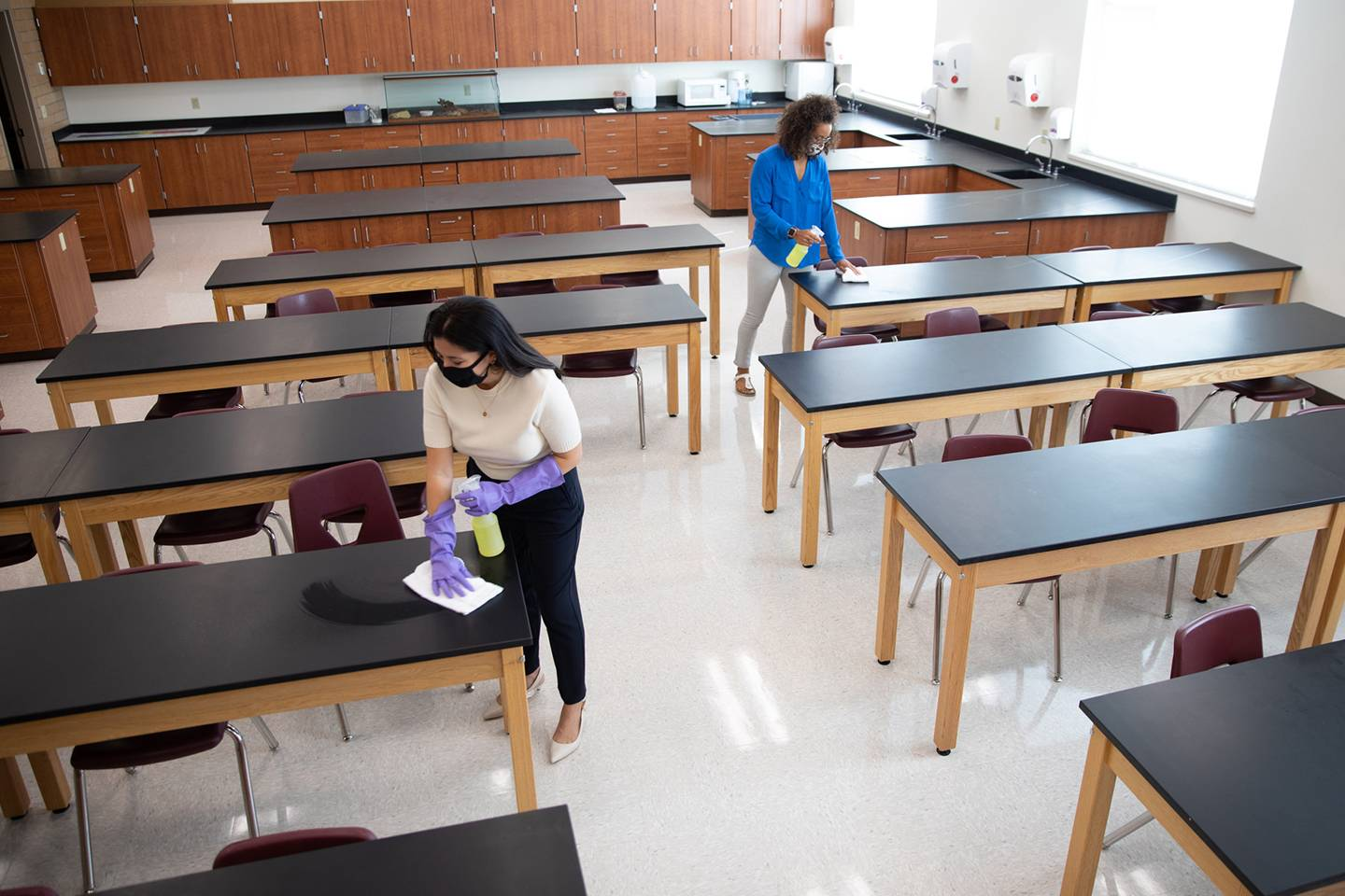 School teachers disinfect a classroom